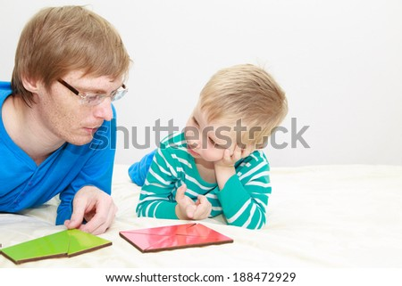 father and son playing with puzzle, early education concept