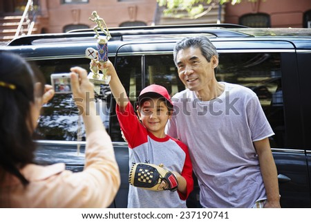 Father and Son Posing for Camera - stock photo