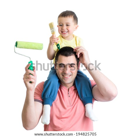 father and son ready to paint the room - stock photo