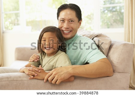 Father And Son Relaxing At Home - stock photo