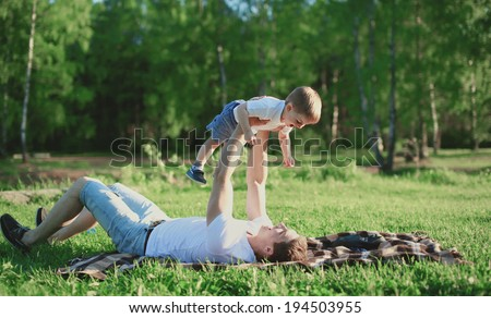 Father and son rest in the park, having fun, family, happiness, vacation, childhood, father's day - concept - stock photo