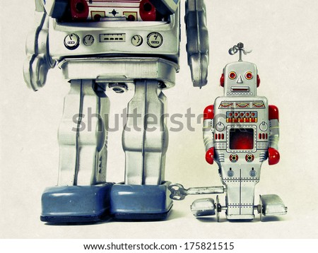 father and son robot toys - stock photo