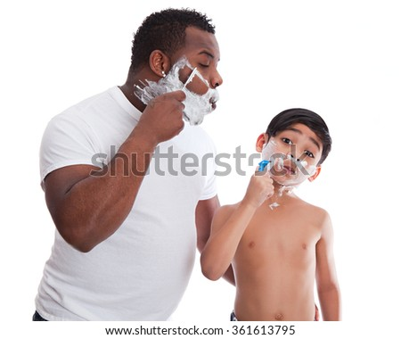 Father and son shaving.  Isolated on white. - stock photo