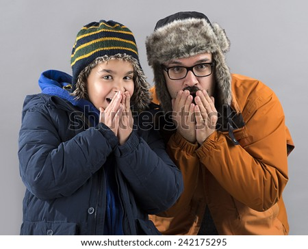Father and Son Shiver with Cold - stock photo
