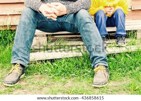 Father and son sitting on staircase wood together. - stock photo