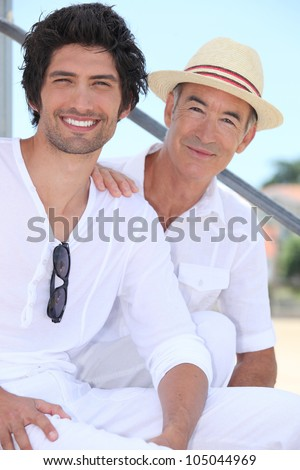 Father and son sitting on stairs - stock photo