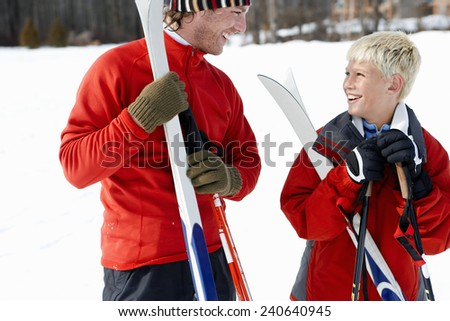 Father and Son Skiing - stock photo