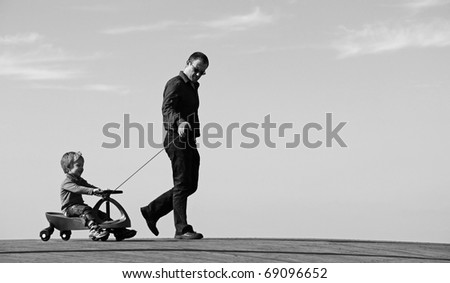 Father and son spend free time together - stock photo