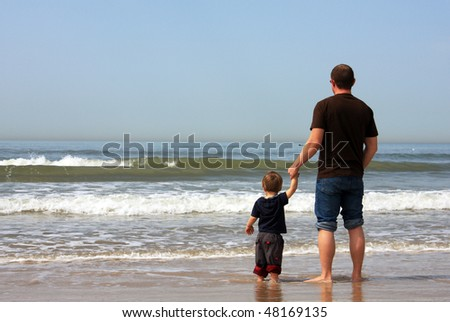 Father and son spend time together at sea. - stock photo