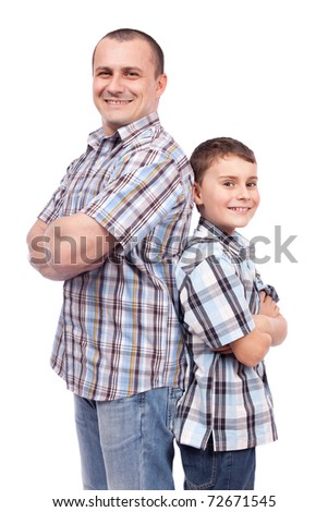 Father and son standing back to back, isolated on white background - stock photo