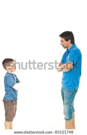 Father and son standing face to face and having conversation isolated on white background - stock photo