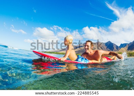 Father and Son Surfing Together - stock photo