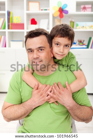 Father and son together at home - portrait