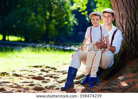 father and son together enjoying nature