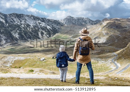 Father and son travel in autumn mountains Durmitor, Montenegro