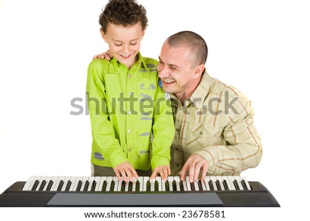 Father and son trying to play to a piano - stock photo