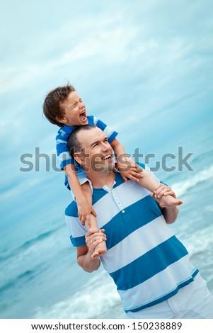 father and son walking on beach, outdoor