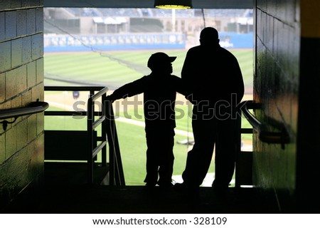 Father and Son watching a baseball game. - stock photo