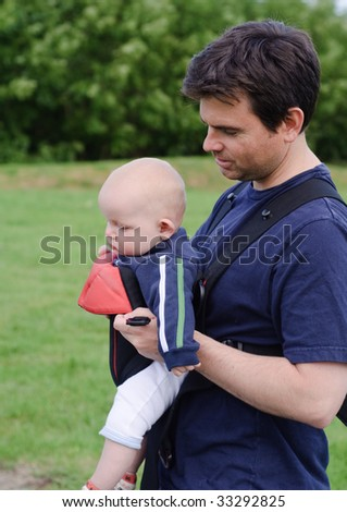 father and son with baby Sling  Carrier