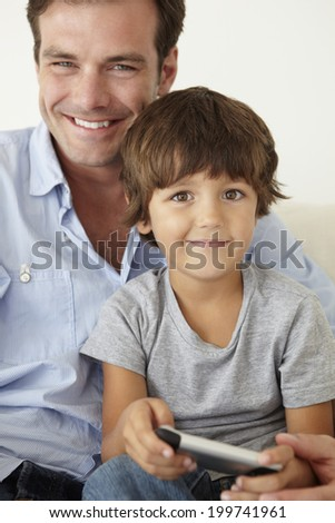 Father and son with cellphone - stock photo