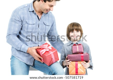 Father and son with presents isolated on white background. Concept of a holiday, birthday and Christmas.