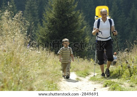 Father and sons on the trip in nature