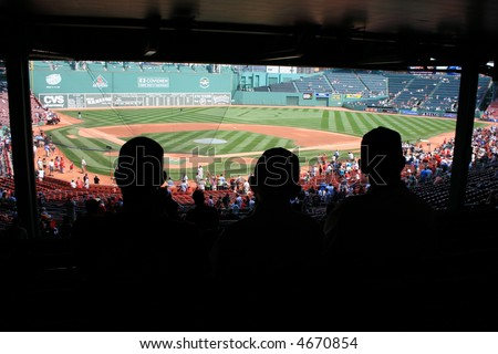 Father and sons watching a game at Fenway Park, Boston. - stock photo