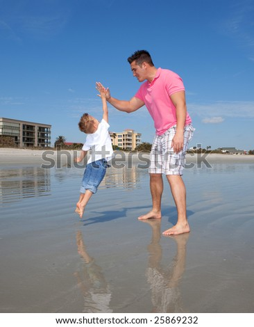 Father and sun and high five. - stock photo