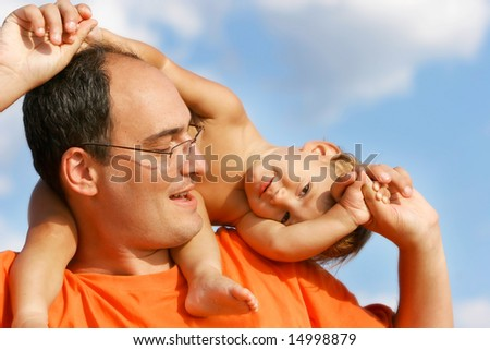father and sun outdoor portrait - stock photo