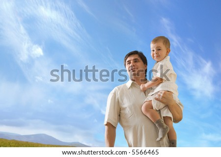 Father and 2 years old baby boy looking at the future. - stock photo
