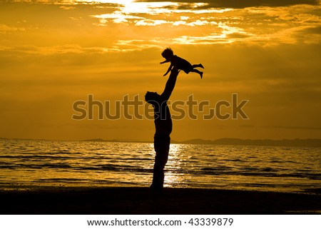 Father andSson on the Beach - Silhouette Shot - stock photo