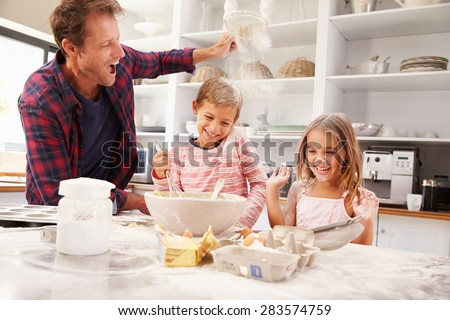 Father baking with children - stock photo