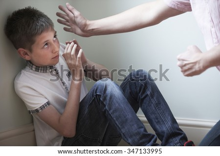 Father Being Physically Abusive Towards Son - stock photo