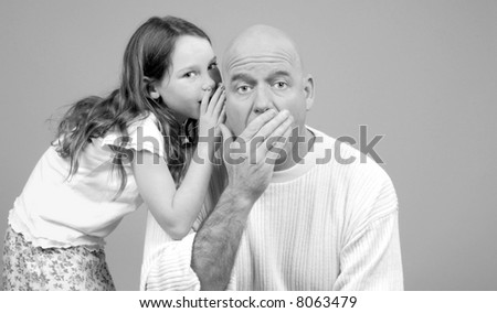Father Being Told Secret by Daughter - stock photo