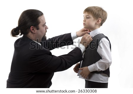 Father-businessman readjusting his son's necktie