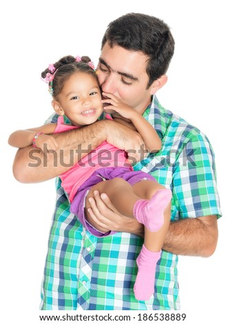 Father carrying and kissing his funny small multiracial daughter isolated on white - stock photo