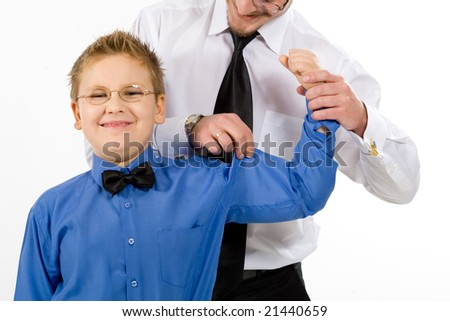 Father checking his son muscles