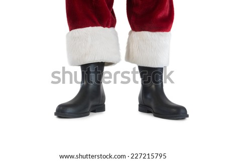Father Christmas boots and legs on white background - stock photo