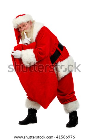 father Christmas carrying his sack as he tip toes - stock photo
