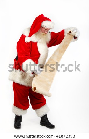 father christmas checking his list studio shot on plain background - stock photo
