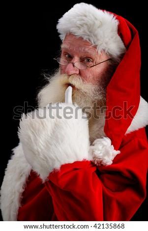 father Christmas gesturing shush - stock photo
