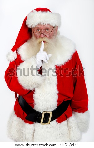 father christmas   gesturing shush studio shot on off white - stock photo