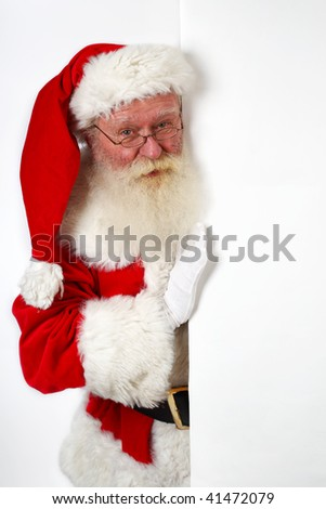 father christmas holding a blank banner - stock photo