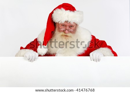 father christmas holding a blank sign with room for text - stock photo