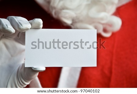 Father Christmas holding a clear white card with copy space