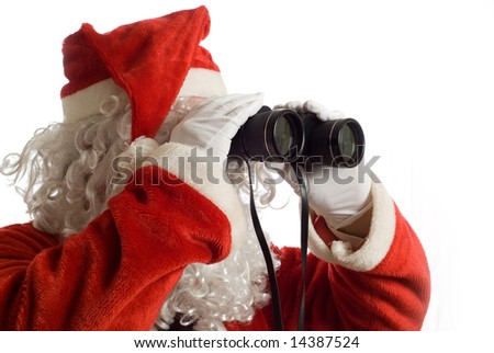 Father Christmas looking at the future business strategy with binoculars to the right - stock photo