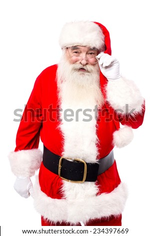 Father christmas looking into the camera - stock photo