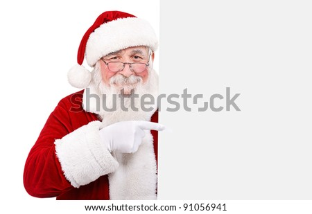 Father Christmas pointing at banner on off white background - stock photo