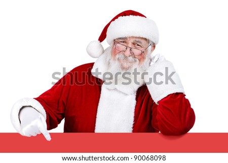 Father Christmas pointing at red banner,  isolated on white background - stock photo