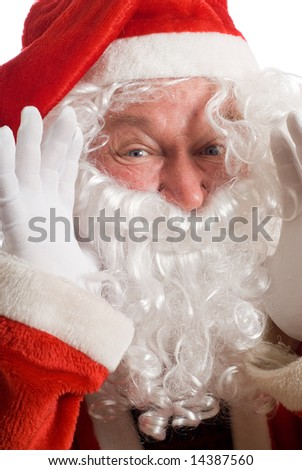 Father Christmas shouting something with hands at side of beard and mouth - stock photo